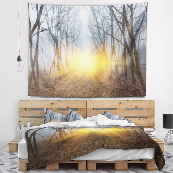 Designart 'Yellow Sun Rays in Misty Forest' Landscape Photography Wall Tapestry