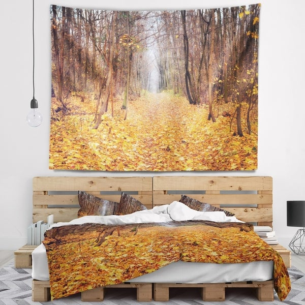 Designart 'Yellow Fallen Leaves in Morning' Landscape Photography Wall Tapestry