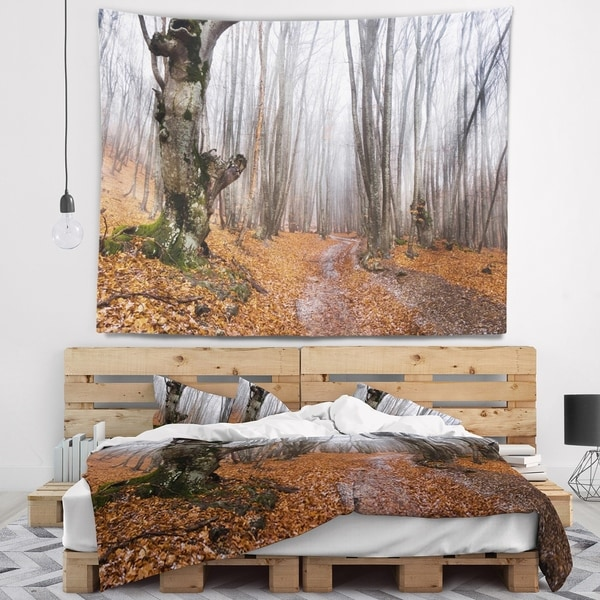 Designart 'Road Covered by Fallen Leaves' Modern Forest Wall Tapestry