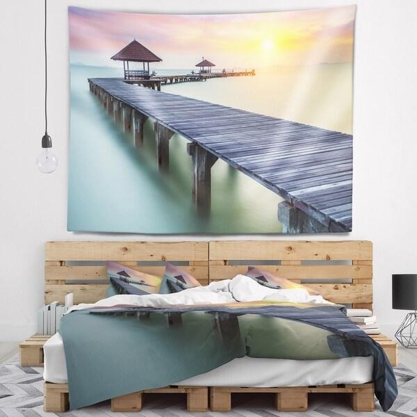 Designart 'Long Wooden Bridge into the Sunrise' Pier Seascape Wall Tapestry