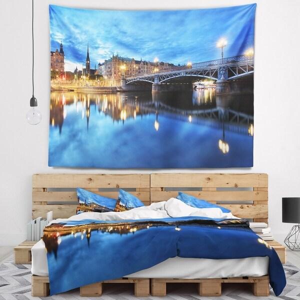 Designart 'Illuminated Blue Stockholm' Cityscape Wall Tapestry