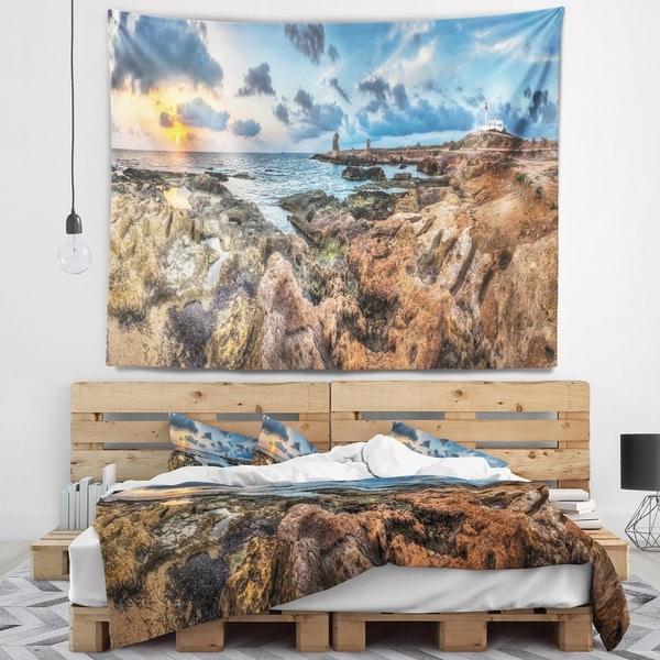 Designart 'Blue Sky over Rough Rocky Coast' Seashore Wall Tapestry