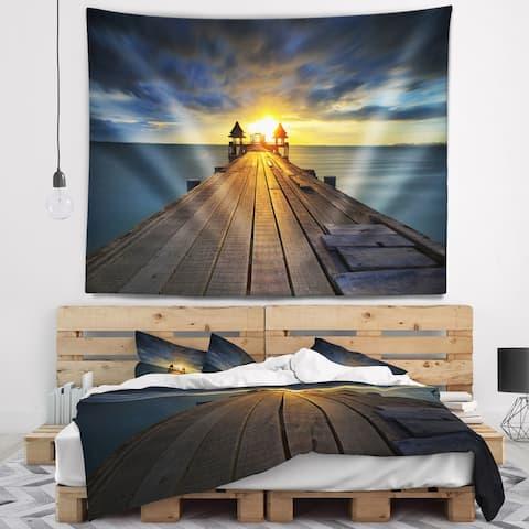 Designart 'Illuminated Wooden Bridge in Sunlight' Pier Seascape Wall Tapestry