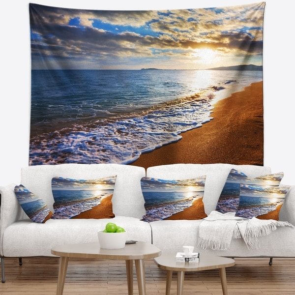 Designart 'Heavy Clouds Over Morning Beach' Seashore Wall Tapestry