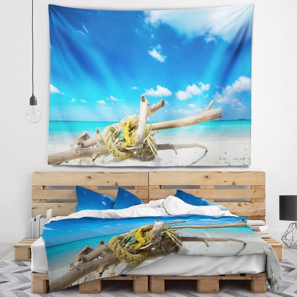 Designart 'Deadwood on White Sand Beach' Seashore Wall Tapestry