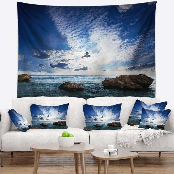 Designart 'Rocky Beach with White Clouds' Modern Beach Wall Tapestry