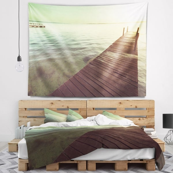 Designart 'Wooden Boardwalk over Clear Waters' Bridge Wall Tapestry