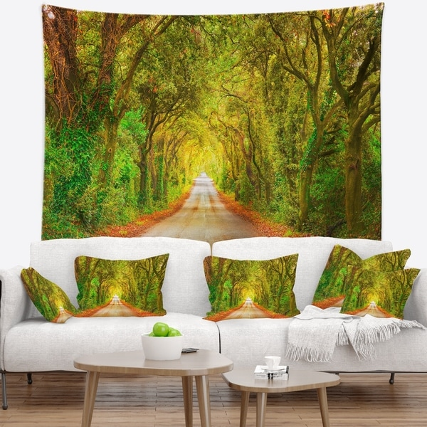 Designart 'Fall Greenery and Road Straight Ahead' Forest Wall Tapestry