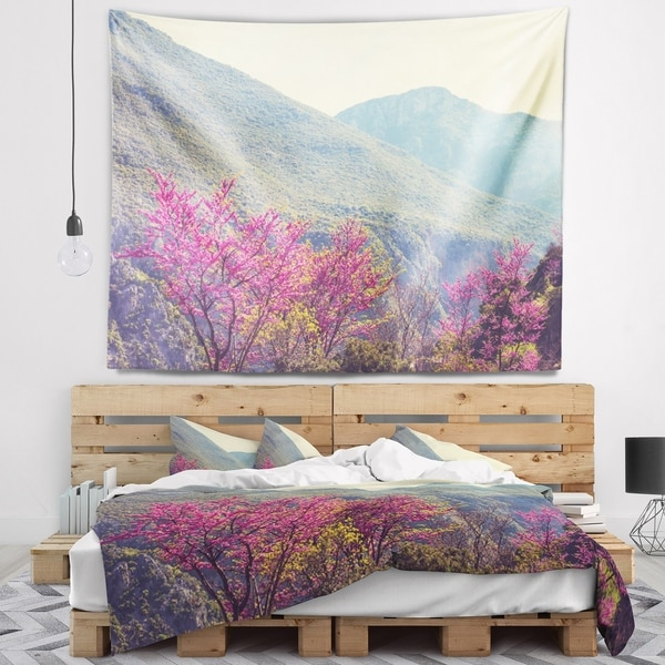 Designart 'Pink Blossoming Flowers in Mountains' Floral Wall Tapestry