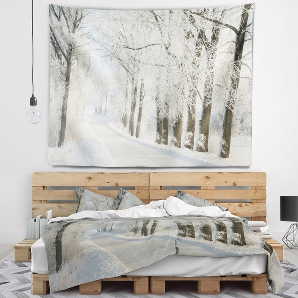 Designart 'Winter Rural Road Among Frosted Trees' Forest Wall Tapestry