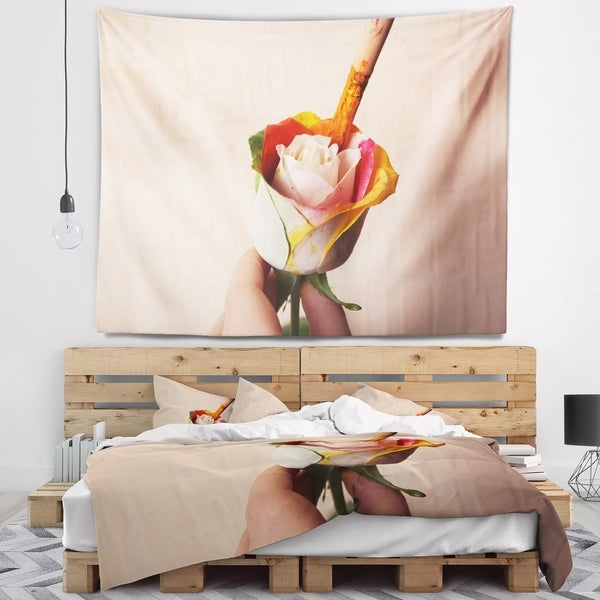 Designart 'Person Painting Beautiful Rose' Floral Wall Tapestry