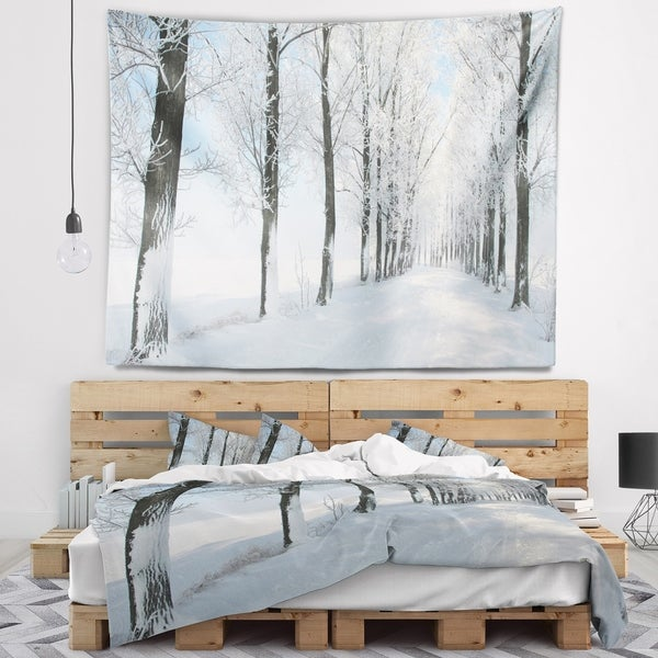Designart 'Beautiful Winter Forest Lane Photo' Forest Wall Tapestry