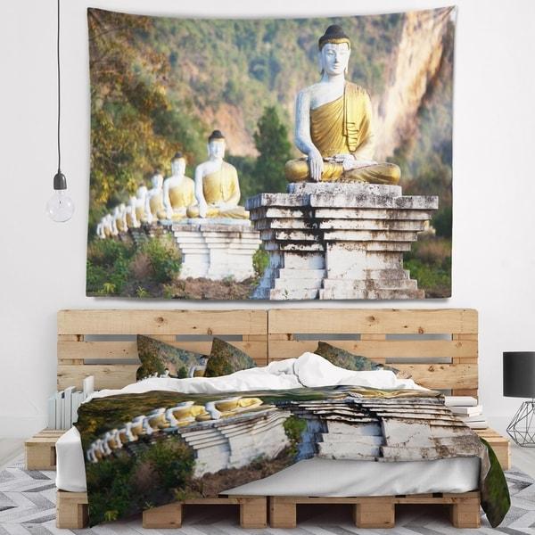 Designart 'Beautiful Row of Buddha Statues' Landscape Wall Tapestry
