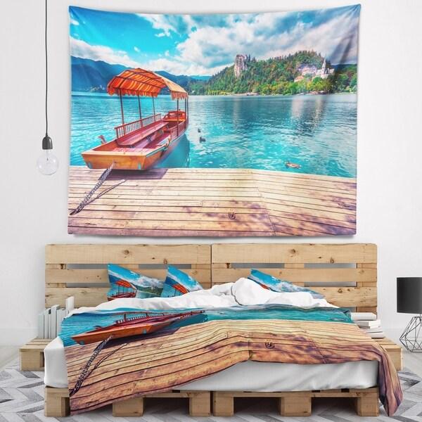 Designart 'Boat in Lake Bled In Julian Alps' Landscape Wall Tapestry