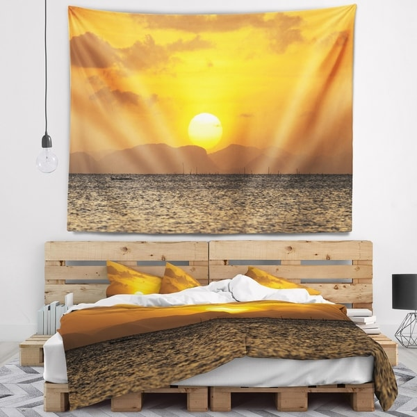 Designart 'Yellow Sunset and Brown Ocean' Seashore Wall Tapestry