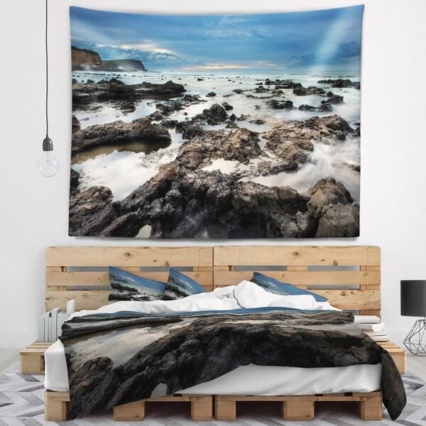 Designart 'Rocky Seashore with Blue Sky Over' Seashore Wall Tapestry