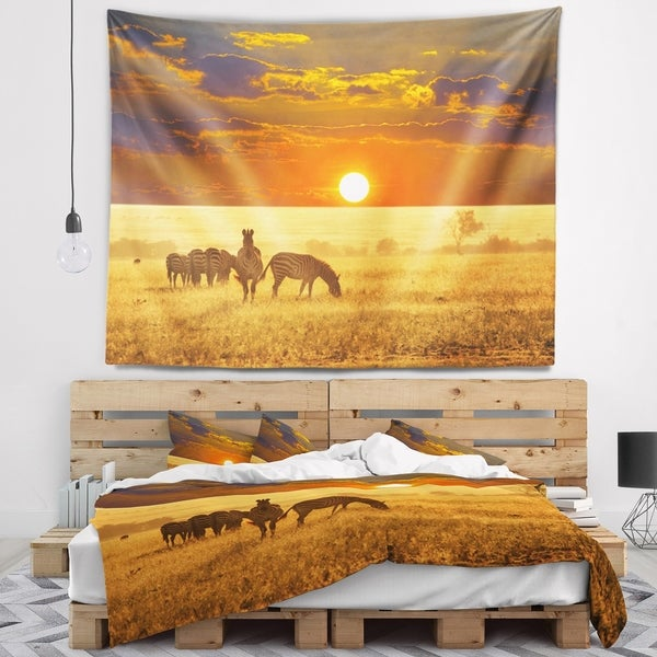 Designart 'Group of Zebras Grazing At Sunset' Animal Wall Tapestry
