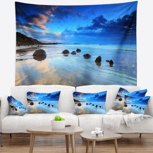 Designart 'Moeraki Boulders Under Cloudy Sky' Seashore Photo Wall Tapestry
