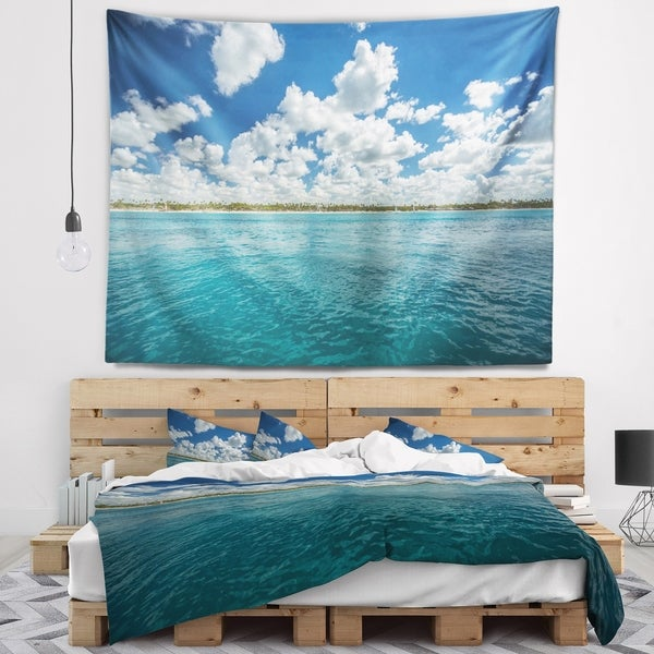 Designart 'White Fluffy Clouds Over Sea' Oversized Beach Wall Tapestry