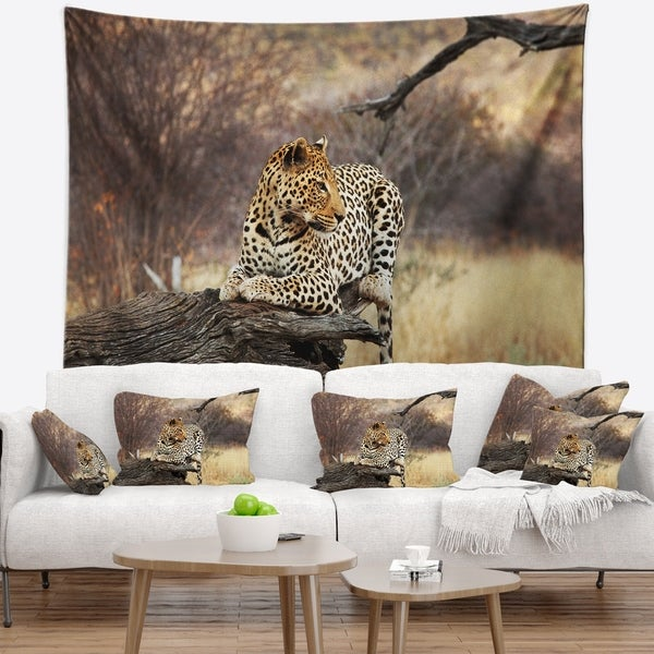 Designart 'Leopard Sitting on Tree Trunk' African Wall Tapestry
