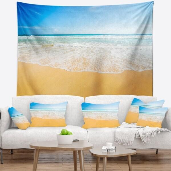 Designart 'Long Waves on Sand under Blue Sky' Seascape Wall Tapestry