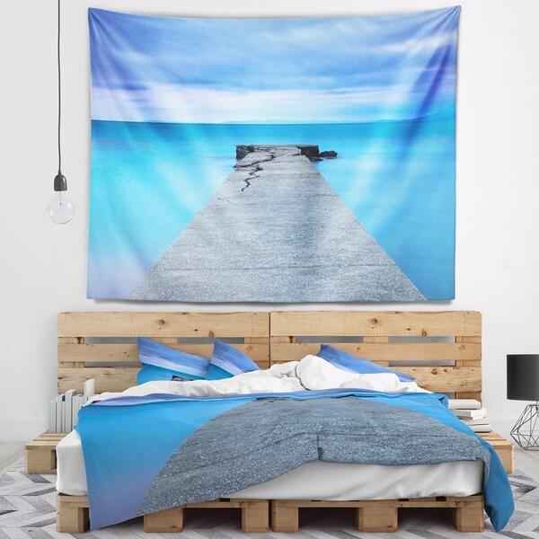 Designart 'Broken Concrete Jetty' Seascape Wall Tapestry