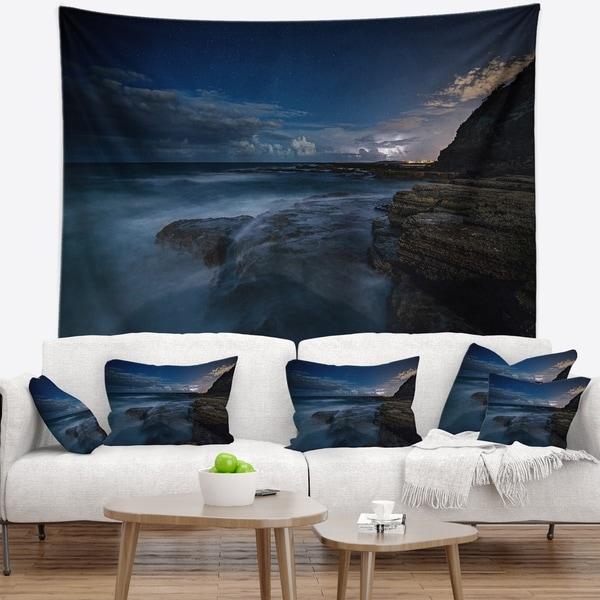Designart 'Rocky Blue Ocean at Nighttime' Seashore Wall Tapestry