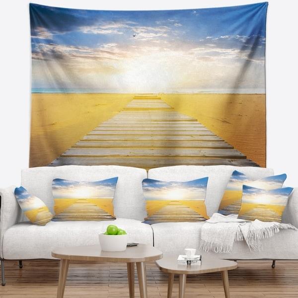 Designart 'Wooden Road at Blue Sea Beach' Sea Bridge Wall Tapestry