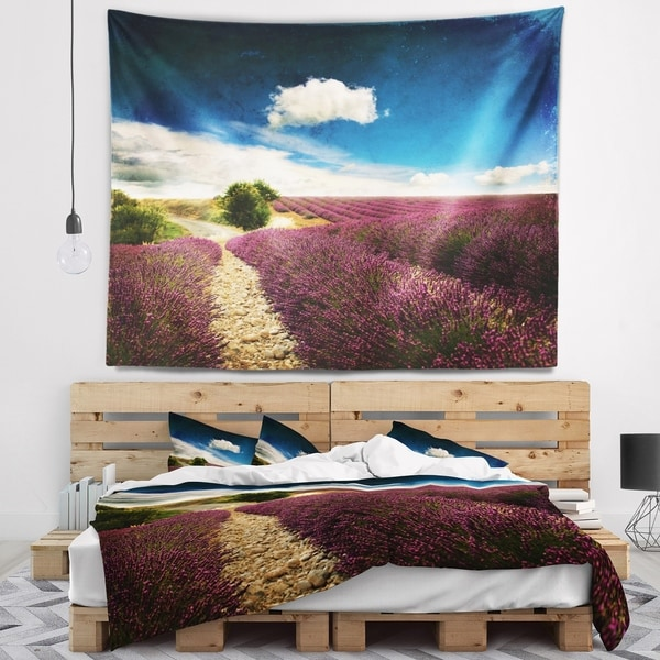 Designart 'Lavender Field with Dramatic Blue Sky' Landscape Wall Tapestry