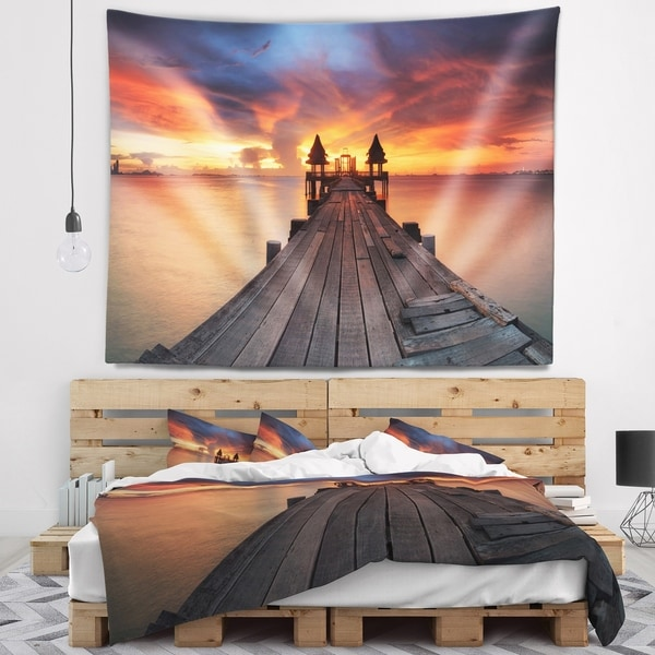Designart 'Glowing Sky and Long Wooden Bridge' Pier Seascape Wall Tapestry