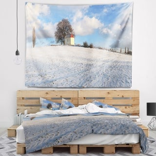 Designart 'Winter Landscape with Chapel' Landscape Wall Tapestry