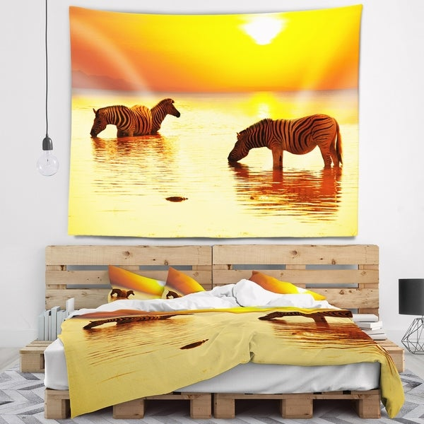Designart 'Zebras Drinking in Lake at Sunset' Animals Wall Tapestry