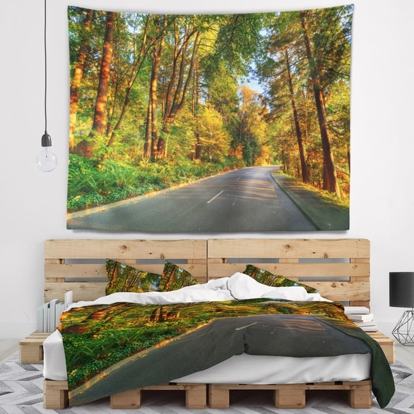 Designart 'Road Through Yellow Forest' Landscape Wall Tapestry