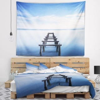 Designart 'Jetty Remains in Blue Lake' Seascape Wall Tapestry (4 options available)