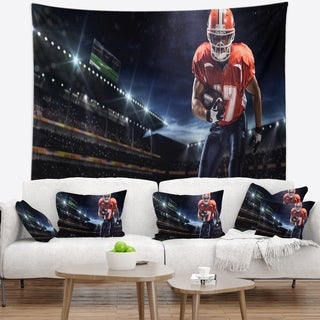 Designart 'American Footballer in Action on Stadium' Sport Wall Tapestry