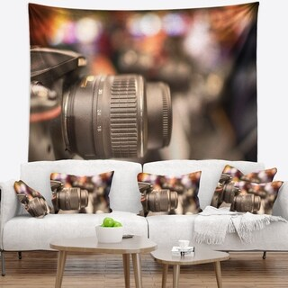 Designart 'Modern Camera in City Electronics Shop' Contemporary Wall Tapestry
