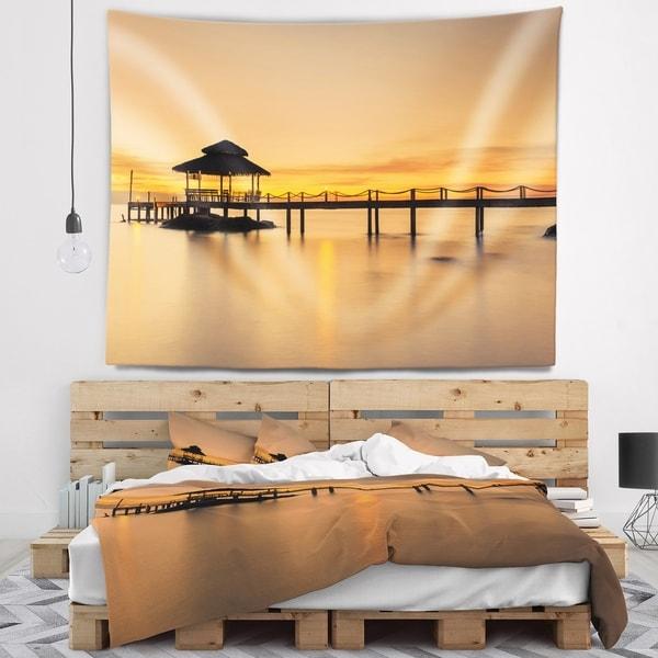 Designart 'Wonderful Wooden Pier and Hut Phuket' Pier Seascape Wall Tapestry