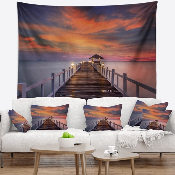 Designart 'Dark Seashore Pier under Colorful Sky' Pier Seascape Wall Tapestry