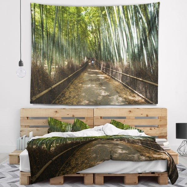 Designart 'Wide Pathway in Bamboo Forest' Forest Wall Tapestry