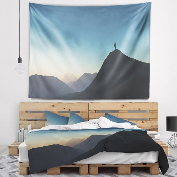 Designart 'Man Looking from Mountain' Landscape Wall Tapestry