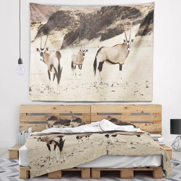 Designart 'Beautiful Wildebeests on Valley' Landscape Wall Tapestry