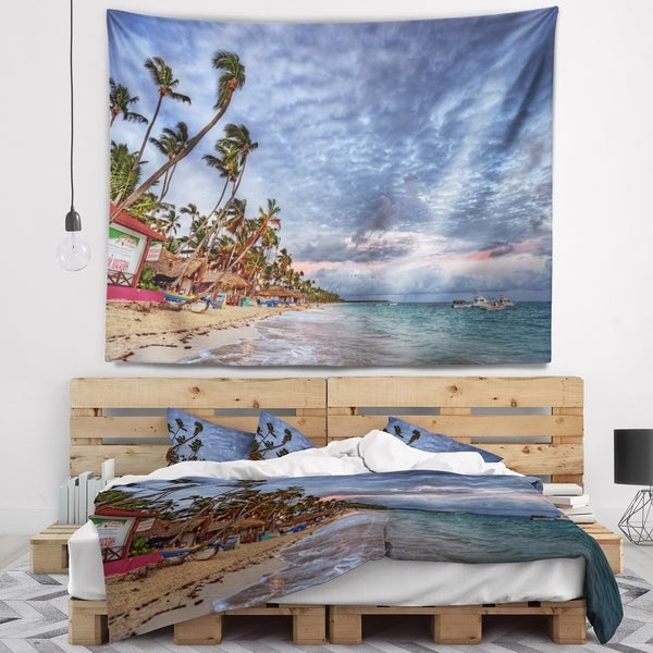 Designart 'Long Palm Trees Bent to Beach' Seashore Wall Tapestry