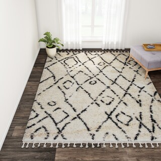 "Carson Carrington Vanlose Abstract Moroccan Diamond Shag Tassel Area Rug - 7'1""0"" x 10'"