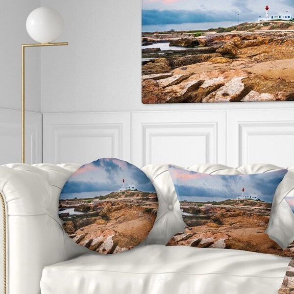 Designart 'Remote Lighthouse on the Rocks' Landscape Printed Throw Pillow