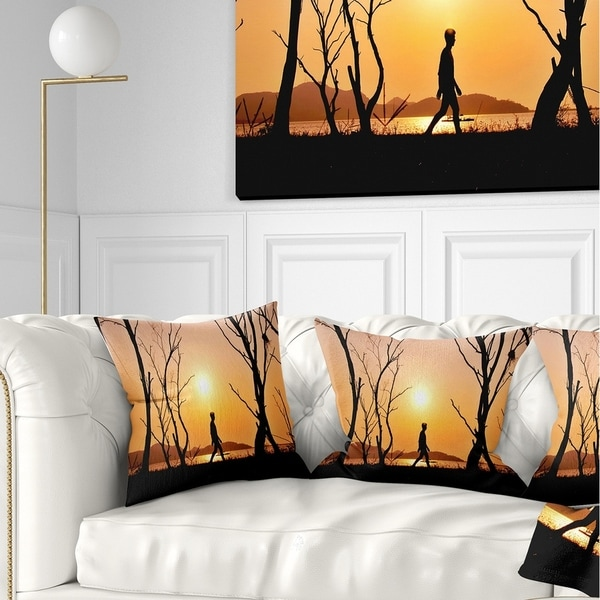 Designart 'Man Walking Alone in Evening' Landscape Photography Throw Pillow