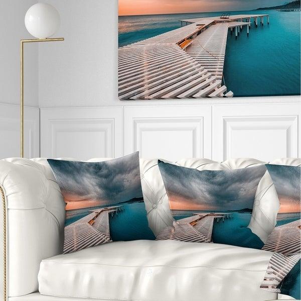 Designart 'Pier in Ocean in Cloudy Day' Seashore Photo Throw Pillow