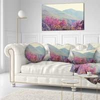 Designart 'Pink Blossoming Flowers in Mountains' Floral Throw Pillow