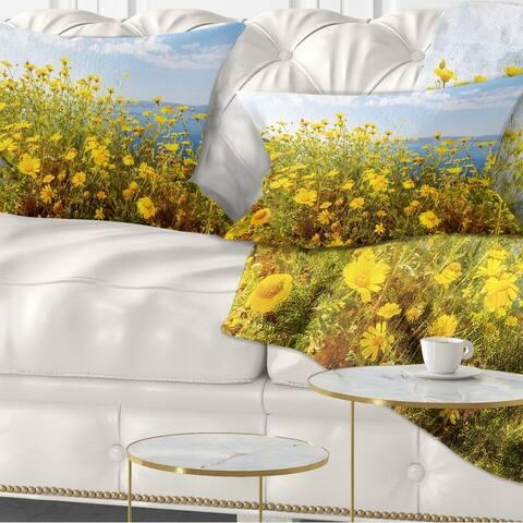 Designart 'Little Yellow Flowers over Seashore' Flower Throw Pillow