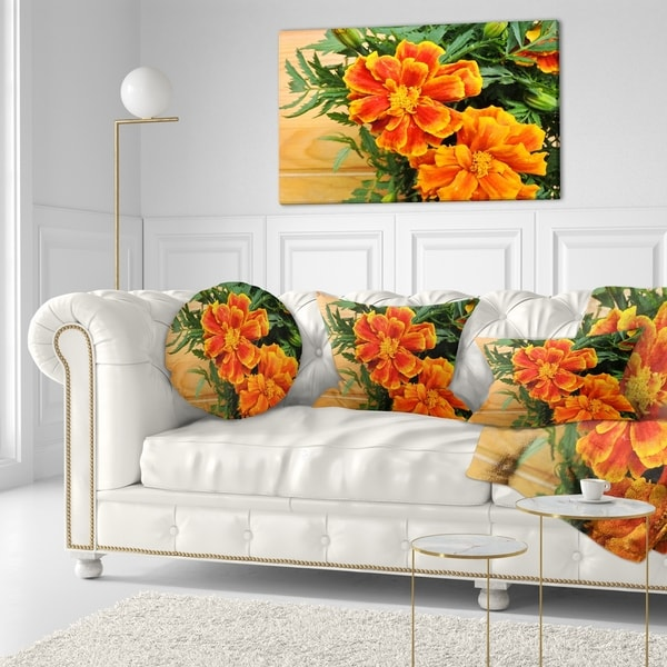 7 Top Tips For Throwing A Grand Party In A Small Home: Shop Designart 'Marigold Flower On Wooden Background