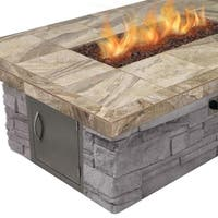 Cultured Stone Gas Fire Pit in Brown with Log Set and Lava Rocks